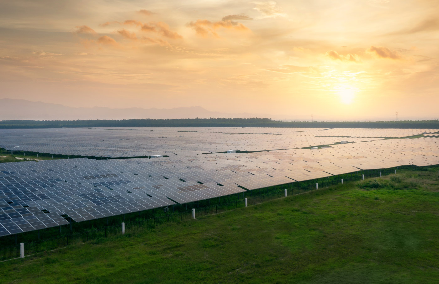 solar energy land pannels sunset green